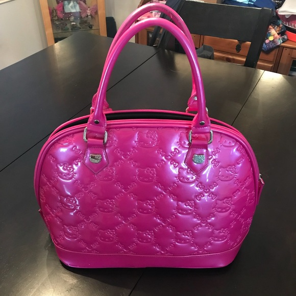 6623e26aa941 Hot pink Hello Kitty - loungefly handbag 💕. M 5acc11b58df470a9073c7f5f
